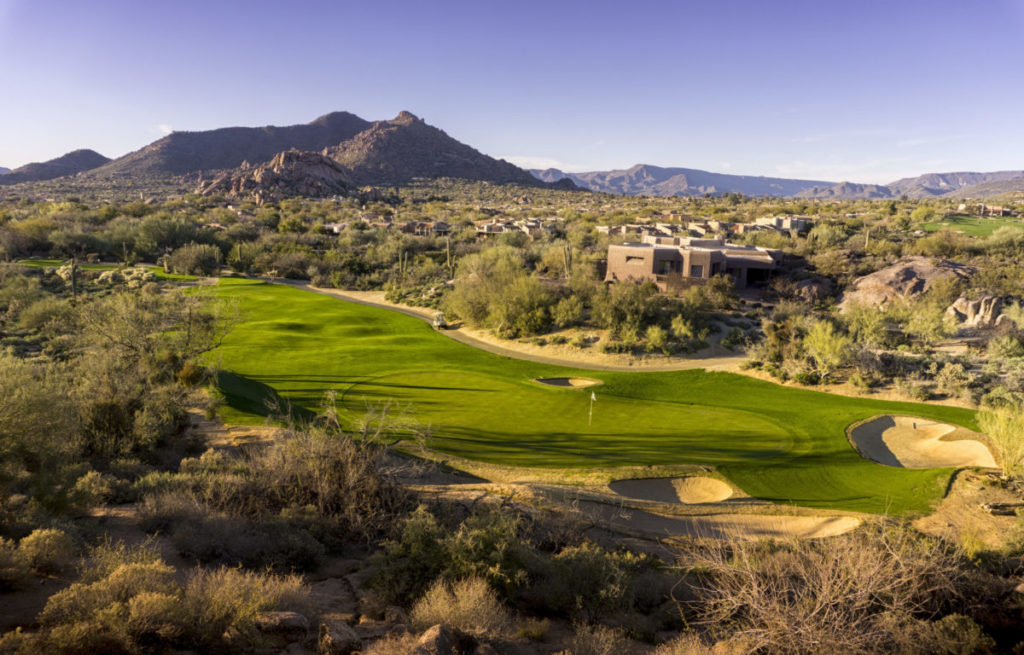 photo of Luxurious Golf Communities in Scottsdale AZ with the sun setting on a golf course